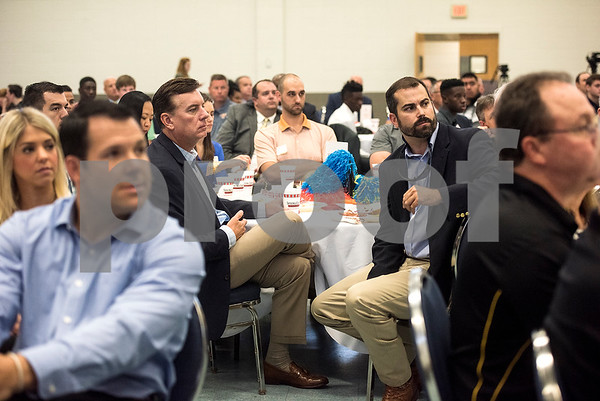 People listen during the 12th annual East Texas Kick-off Luncheon at Harvey Convention Center in Tyler, Texas, on Tuesday, Aug. 15, 2017. Hundreds gathered to enjoy a meal together to listen to speakers and kick off the 2017 football season. (Chelsea Purgahn/Tyler Morning Telegraph)