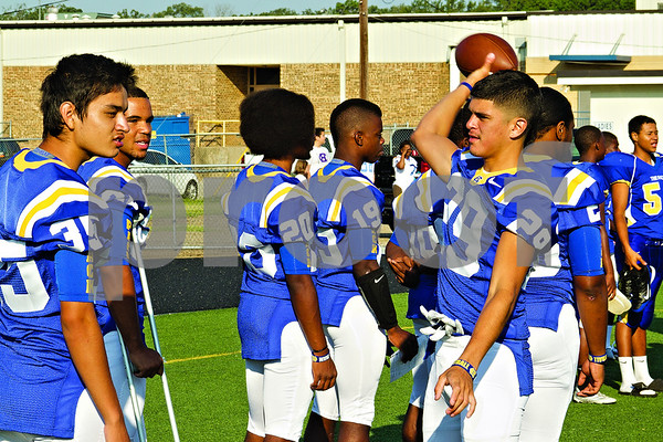 Photo by Shannon Wilson / Tyler Morning Telegraph Chapel Hill varsity football players toss around a footbal while they wait to do their team photo at Chapel Hill High School on Saturday.