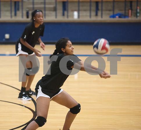 John Tyler High School volleyball player Halfrieda Garrett bumps the ball during practice at the high school gym Wednesday August 2, 2017.  (Sarah A. Miller/Tyler Morning Telegraph)