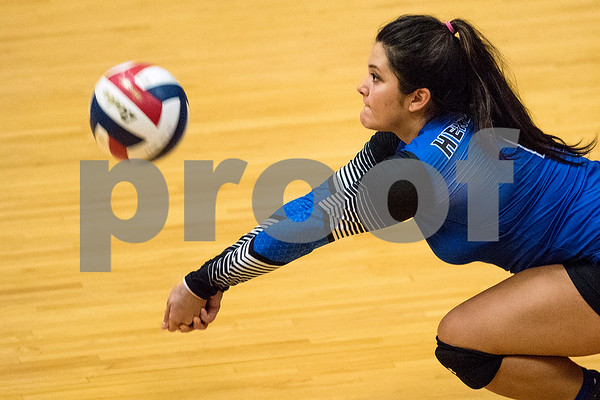 Henderson senior Cassie Hernandez dives to bump a ball during a high school volleyball game at John Tyler High School in Tyler, Texas, on Tuesday, Aug. 22, 2017. (Chelsea Purgahn/Tyler Morning Telegraph)