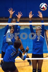 John Tyler junior Talia Smith (7) and freshman Symone Morris (3) jump to block a ball during a high school volleyball game at John Tyler High School in Tyler, Texas, on Tuesday, Aug. 22, 2017. (Chelsea Purgahn/Tyler Morning Telegraph)