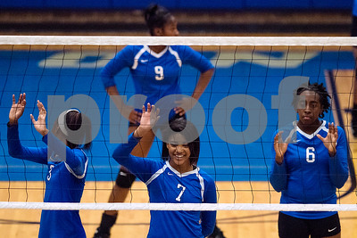 John Tyler players prepare for a point during a high school volleyball game at John Tyler High School in Tyler, Texas, on Tuesday, Aug. 22, 2017. (Chelsea Purgahn/Tyler Morning Telegraph)