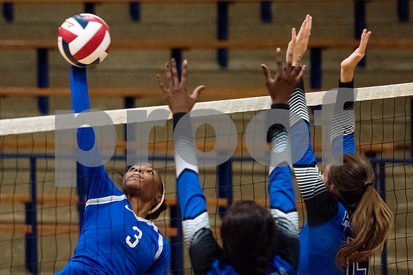 John Tyler freshman Symone Morris (3) spikes the ball during a high school volleyball game at John Tyler High School in Tyler, Texas, on Tuesday, Aug. 22, 2017. (Chelsea Purgahn/Tyler Morning Telegraph)