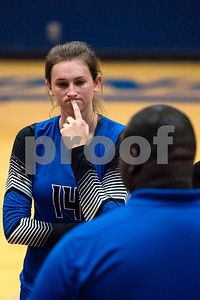 Henderson junior Baleigh Smith (14) listens to her coach during a high school volleyball game at John Tyler High School in Tyler, Texas, on Tuesday, Aug. 22, 2017. (Chelsea Purgahn/Tyler Morning Telegraph)