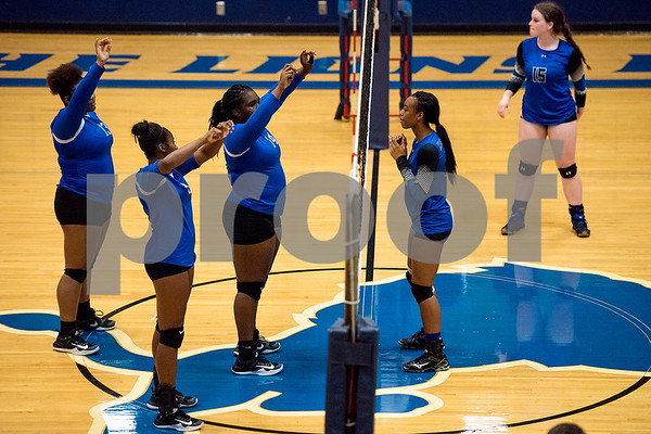 John Tyler and Henderson players prepare for a point during a high school volleyball game at John Tyler High School in Tyler, Texas, on Tuesday, Aug. 22, 2017. (Chelsea Purgahn/Tyler Morning Telegraph)