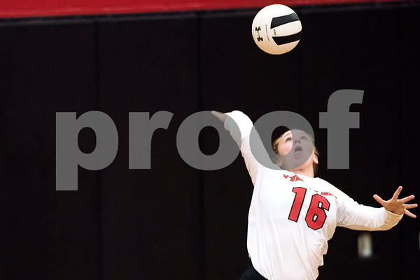 Robert E. Lee sophomore Anna Stone (16) serves the ball during a high school volleyball game at Robert E. Lee High School in Tyler, Texas, on Tuesday, Aug. 22, 2017. (Chelsea Purgahn/Tyler Morning Telegraph)