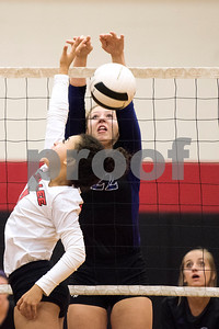 Robert E. Lee sophomore Aliyah Shirley (7) and Hallsville senior Jessica Buderus (22) jump for the ball during a high school volleyball game at Robert E. Lee High School in Tyler, Texas, on Tuesday, Aug. 22, 2017. (Chelsea Purgahn/Tyler Morning Telegraph)