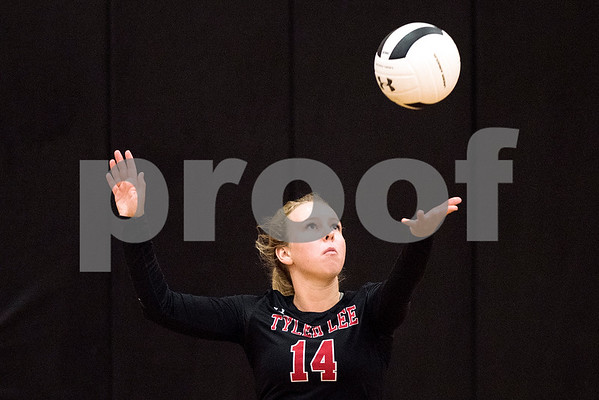 Hallsville sophomore Cassidy Cole (14) serves the ball during a high school volleyball game at Robert E. Lee High School in Tyler, Texas, on Tuesday, Aug. 22, 2017. (Chelsea Purgahn/Tyler Morning Telegraph)
