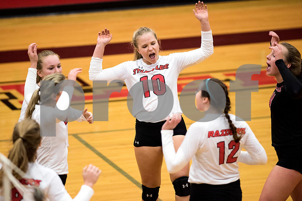 Robert E. Lee junior Macy Behm (10) cheers with her teammates after a point during a high school volleyball game at Robert E. Lee High School in Tyler, Texas, on Tuesday, Aug. 22, 2017. (Chelsea Purgahn/Tyler Morning Telegraph)