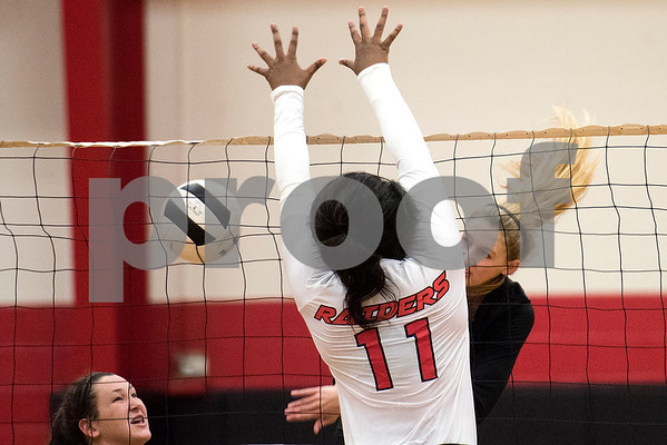 Robert E. Lee senior April Brown (11) attempts to block the ball during a high school volleyball game at Robert E. Lee High School in Tyler, Texas, on Tuesday, Aug. 22, 2017. (Chelsea Purgahn/Tyler Morning Telegraph)