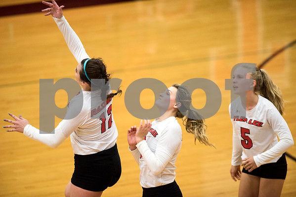 Robert E. Lee players react to the ball during a high school volleyball game at Robert E. Lee High School in Tyler, Texas, on Tuesday, Aug. 22, 2017. (Chelsea Purgahn/Tyler Morning Telegraph)