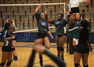 John Tyler High School volleyball players celebrate a point as they play Harmony in the Tyler ISD Invitational Tournament on Thursday Aug. 22, 2019.  (Sarah A. Miller/Tyler Morning Telegraph)