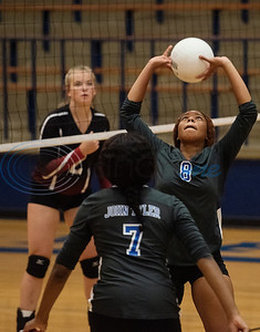 John Tyler High School's (8) Michiah McFarland sets the ball as the Lady Lions play Harmony in the Tyler ISD Invitational Tournament on Thursday Aug. 22, 2019.  (Sarah A. Miller/Tyler Morning Telegraph)