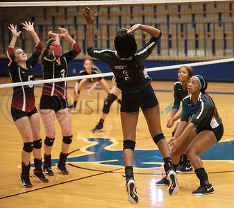 John Tyler High School's (3) Symone Morris jumps to spike the ball as Harmony's Aleah Daily (5) and Kinzee Settles (3) react in the Tyler ISD Invitational Tournament on Thursday Aug. 22, 2019.  (Sarah A. Miller/Tyler Morning Telegraph)