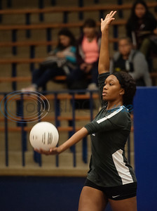 John Tyler High School's (7) Treasure Coleman serves the ball in their match against Harmony in the Tyler ISD Invitational Tournament on Thursday Aug. 22, 2019.  (Sarah A. Miller/Tyler Morning Telegraph)