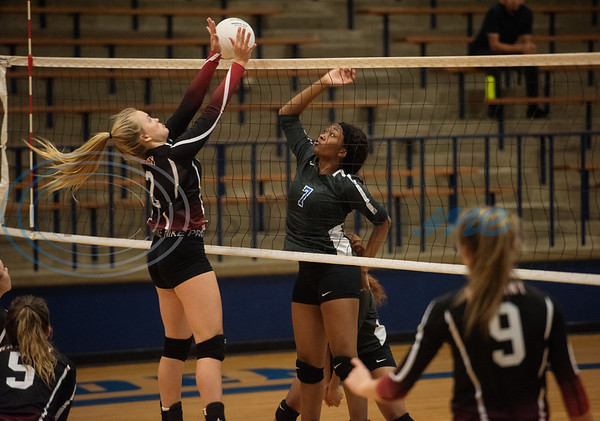 Harmony's (2) Spencer Watkins blocks John Tyler High School's (7) Treasure Coleman in the Tyler ISD Invitational Tournament on Thursday Aug. 22, 2019.  (Sarah A. Miller/Tyler Morning Telegraph)
