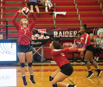 Robert E. Lee High School's Anna Stone (7) sets the ball for Hope Casel (15) in their match against Quitman in the Tyler ISD Invitational Tournament on Thursday Aug. 22, 2019.  (Sarah A. Miller/Tyler Morning Telegraph)