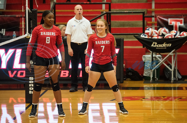 Robert E. Lee High School's I'Onna Jones (8) and Anna Stone (7) take their positions for the start of a match against Quitman in the Tyler ISD Invitational Tournament on Thursday Aug. 22, 2019.  (Sarah A. Miller/Tyler Morning Telegraph)