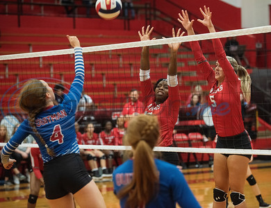 Quitman's Lindsey Hornaday (4) spikes the ball as Robert E. Lee's Je'Myiia Johnson (12) and Claire Trosclair (5) jump to block it during the Tyler ISD Invitational Tournament on Thursday Aug. 22, 2019.  (Sarah A. Miller/Tyler Morning Telegraph)