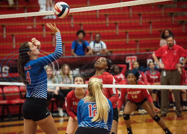 Quitman High School's Ava Burroughs (14) sends the ball back over the net as they play Robert E. Lee High School in the Tyler ISD Invitational Tournament on Thursday Aug. 22, 2019.  (Sarah A. Miller/Tyler Morning Telegraph)