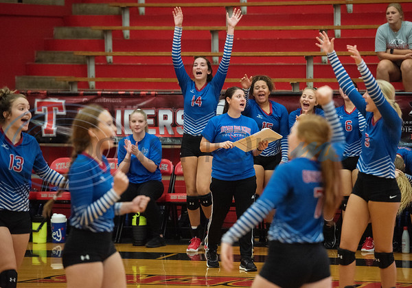 Quitman High School volleyball players celebrate a point as they play Robert E. Lee High School in the Tyler ISD Invitational Tournament on Thursday Aug. 22, 2019.  (Sarah A. Miller/Tyler Morning Telegraph)