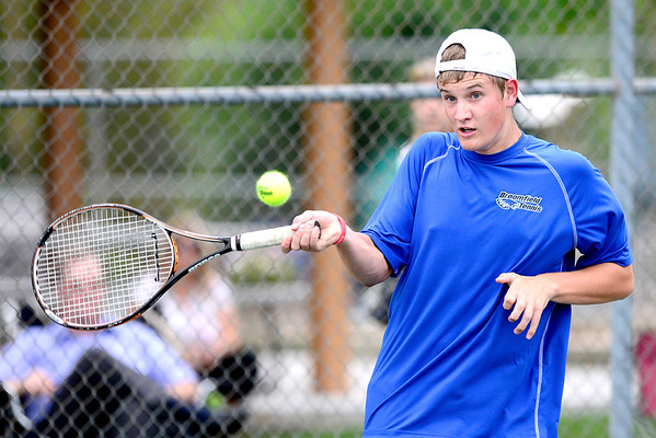 Broomfield's Adam Clark returns the ball to Monarch's Jack Shanahan during their match in Broomfield, Colorado August 23, 2012. BOULDER DAILY CAMERA/ Mark Leffingwell