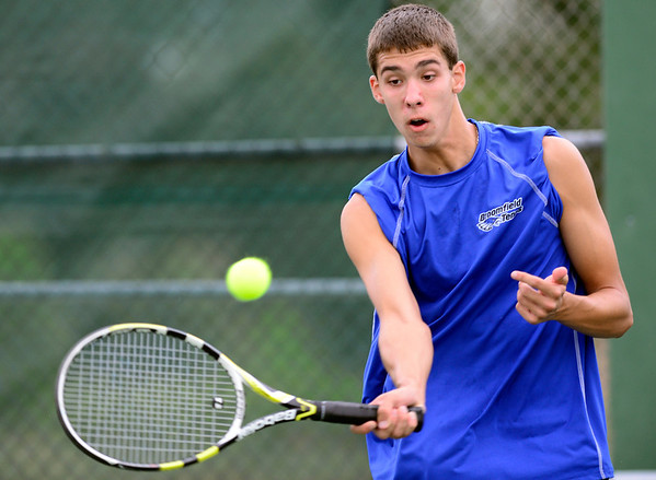 Broomfield's Brandon Hall returns the ball to Monarch's Danny Wrightduring their match in Broomfield, Colorado August 23, 2012. BOULDER DAILY CAMERA/ Mark Leffingwell