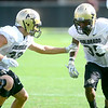 CU defensive back Richard Yates (left) covers defensive back Brandon Brisco (right) during practice at the University of Colorado in Boulder, Colorado August 23, 2012.  DAILY CAMERA MARK LEFFINGWELL