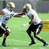 CU defensive back Brandon Brisco (right) covers defensive back Richard Yates (left) during practice at the University of Colorado in Boulder, Colorado August 23, 2012.  DAILY CAMERA MARK LEFFINGWELL