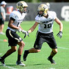 CU defensive back Isaac Archuleta (right) covers defensive back Marques Mosley (left) during practice at the University of Colorado in Boulder, Colorado August 23, 2012.  DAILY CAMERA MARK LEFFINGWELL