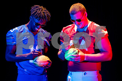 John Tyler wide receiver Ke'Andre Street (13) and Robert E. Lee offensive lineman Beaux Limmer (54) sign footballs at the Pigskin Preview photoshoot at Caldwell Auditorium in Tyler, Texas, on Wednesday, July 18, 2018. (Chelsea Purgahn/Tyler Morning Telegraph)