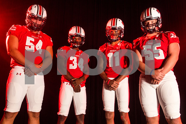 Robert E. Lee offensive lineman Beaux Limmer (54), running back and wide receiver Malik Hall (34), wide receiver Zaylon Walker (11) and offensive lineman Nathan Kuehn (55) at the Pigskin Preview photoshoot at Caldwell Auditorium in Tyler, Texas, on Wednesday, July 18, 2018. (Chelsea Purgahn/Tyler Morning Telegraph)