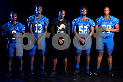 John Tyler running back Roderick Hawkins (6), wide receiver Ke'Andre Street (13) head coach Ricklan Holmes, offensive and defensive lineman JaBralen Yarber (52) and offensive and defensive lineman Chance Billington (70) at the Pigskin Preview photoshoot at Caldwell Auditorium in Tyler, Texas, on Wednesday, July 18, 2018. (Sarah A. Miller/Tyler Morning Telegraph)