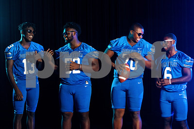 John Tyler wide receiver Ke'Andre Street (13), offensive and defensive lineman JaBralen Yarber (52), offensive and defensive lineman Chance Billington (70) and running back Roderick Hawkins (6) at the Pigskin Preview photoshoot at Caldwell Auditorium in Tyler, Texas, on Wednesday, July 18, 2018. (Chelsea Purgahn/Tyler Morning Telegraph)