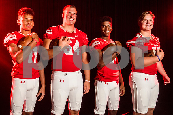 Robert E. Lee wide receiver Zaylon Walker (11), offensive lineman Beaux Limmer (54), running back and wide receiver Malik Hall (34) and offensive lineman Nathan Kuehn (55) at the Pigskin Preview photoshoot at Caldwell Auditorium in Tyler, Texas, on Wednesday, July 18, 2018. (Chelsea Purgahn/Tyler Morning Telegraph)