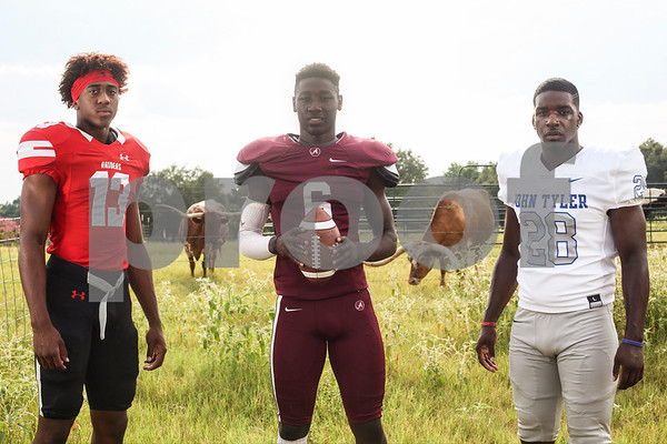 Robert E. Lee's Chance Amie, Arp's Demarvion Overshown and John Tyler's Martrevious Allison pose for a portrait at the Dorsey family ranch in Whitehouse, Texas, on Tuesday, Aug. 1, 2017. (Chelsea Purgahn/Tyler Morning Telegraph)