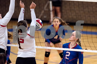 Alba-Golden junior Ginny Carson (2) looks at the ball after spiking it during the Tyler Invitational volleyball tournament at John Tyler High School in Tyler, Texas, on Friday, Aug. 25, 2017. (Chelsea Purgahn/Tyler Morning Telegraph)