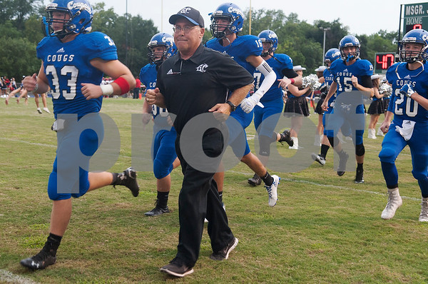 Grace Community School football coach Mike Maddox takes the field with his team during the Azalea Orthopedics and Texas Spine & Joint Hospital Tyler Football Classic at McCallum Stadium on the campus of Bishop Thomas K. Gorman Regional Catholic School Friday night August 26, 2016.  (Sarah A. Miller/Tyler Morning Telegraph)