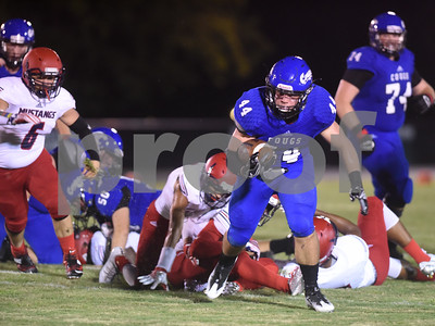 Grace Community School's Josh Spitzer breaks away from Life High School defenders during the Azalea Orthopedics and Texas Spine & Joint Hospital Tyler Football Classic at McCallum Stadium on the campus of Bishop Thomas K. Gorman Regional Catholic School Friday night August 26, 2016.  (Sarah A. Miller/Tyler Morning Telegraph)
