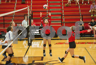 Robert E. Lee's (7) Aliyah Shirley sets the ball for (6) Ashley Oldham to spike it as they play Eustace in the Tyler Invitational held Friday at Robert E. Lee High School.  (Sarah A. Miller/Tyler Morning Telegraph)