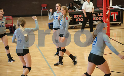 Bullard High School volleyball players celebrate a point during their game against Bishop Thomas K. Gorman in the Tyler Invitational held Friday at Robert E. Lee High School.  (Sarah A. Miller/Tyler Morning Telegraph)
