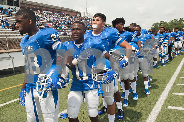 The John Tyler High School football team lines up for the National Anthem before the football game against Plano West Saturday August 27, 2016 at Christus Trinity Mother Frances Rose Stadium.  (Sarah A. Miller/Tyler Morning Telegraph)