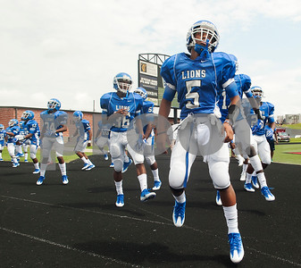 The John Tyler High School football team, including (5) Devlen Woods, right, warms up before their football game against Plano West Saturday August 27, 2016 at Christus Trinity Mother Frances Rose Stadium.  (Sarah A. Miller/Tyler Morning Telegraph)