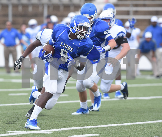 John Tyler High School's Justin Samples carries the ball in the first half of their game against Plano West Saturday August 27, 2016 at Christus Trinity Mother Frances Rose Stadium.  (Sarah A. Miller/Tyler Morning Telegraph)