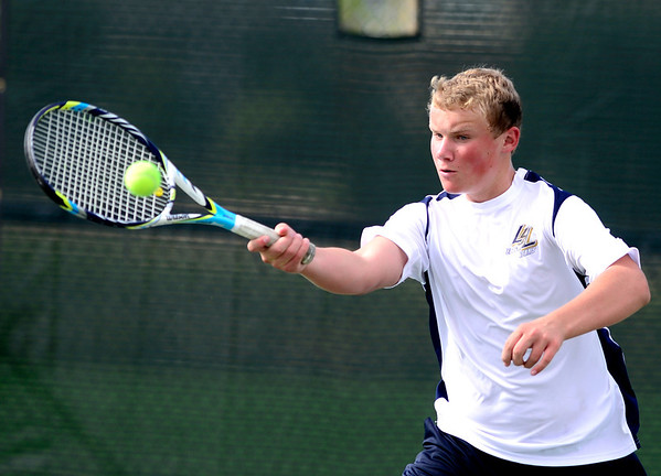 Legacy's Alec Jensea returns the ball during his match against Windsor's Cole Tomberlin at Legacy High School in Broomfield, Colorado August 28, 2012.  DAILY CAMERA MARK LEFFINGWELL