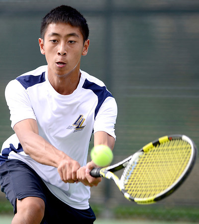 Legacy's Austin Phan back hands the ball during his match against Windsor's Mark Gueswell at Legacy High School in Broomfield, Colorado August 28, 2012.  DAILY CAMERA MARK LEFFINGWELL
