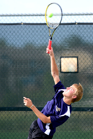 Legacy's Dave Rosencrans severs the ball during his doubles match against Windsor's Clay Varboc and Bailey Smith at Legacy High School in Broomfield, Colorado August 28, 2012.  DAILY CAMERA MARK LEFFINGWELL