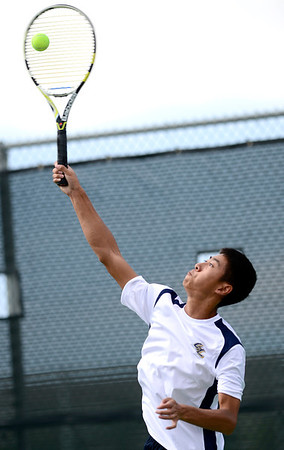 Legacy's Austin Phan serves the ball during his match against Windsor's Mark Gueswell at Legacy High School in Broomfield, Colorado August 28, 2012.  DAILY CAMERA MARK LEFFINGWELL