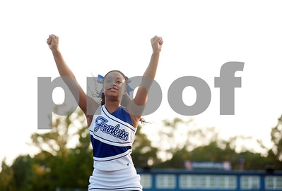 photo by Sarah A. Miller/Tyler Morning Telegraph  Frankston High School cheerleader sophomore Kaitlyn Mills, 15, performs during the Brook Hill Classic football game against The Brook Hill School Thursday night at Brook Hill.