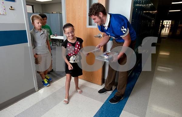 photo by Sarah A. Miller/Tyler Morning Telegraph  Grace Community School's running back Kade Clayton and children Levi Powell, 9, Brett Brown, 10, and Marissa Buie, 7.